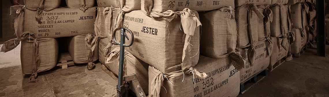 Photo of hop bales on a pallet truck. Purely decoroative for the delivery page